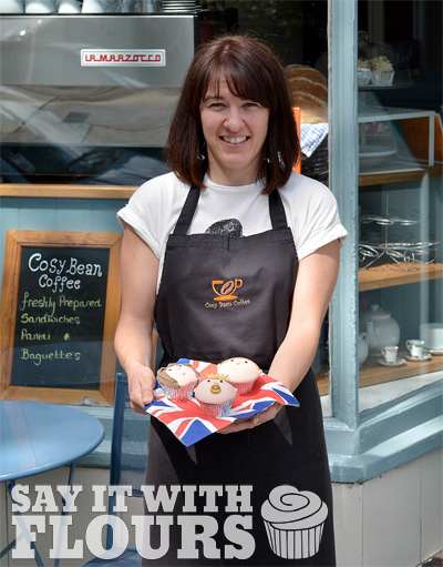Nicola from Cosy Bean Coffee showcasing the cupcakes